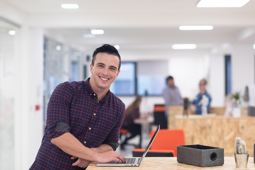 portrait of young businessman in casual clothes at modern  startup business office space,  working on laptop  computer-2